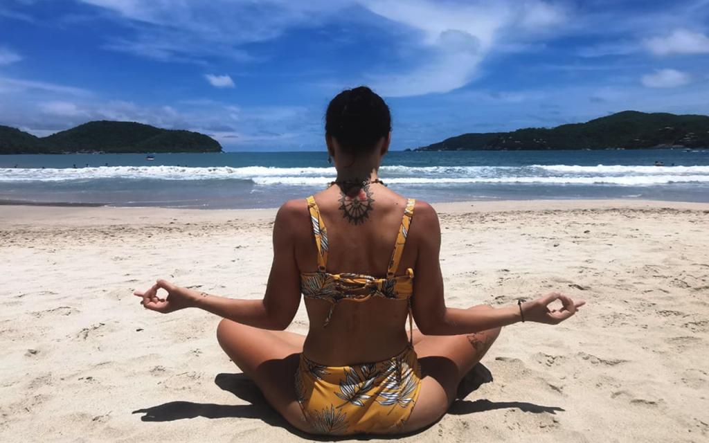 Girl doing yoga on a Mexican beach